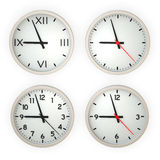 Clocks. Four different wall clocks isolated over a white background. This is a 3D rendered picture royalty free stock photo