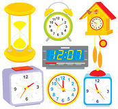 Clocks. Vector clip-arts of clocks and alarm clocks, on a white background Royalty Free Stock Image