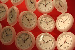 Clocks. Hanging on the red wall royalty free stock images