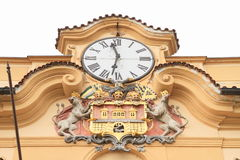 Clocks and blazon. Of city Prague (Czech Republic) with two lions with two tails Royalty Free Stock Photography