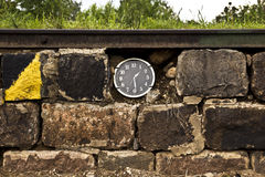 Clocks in the brick wall Royalty Free Stock Photography