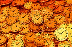 Clocks and  coins Royalty Free Stock Image