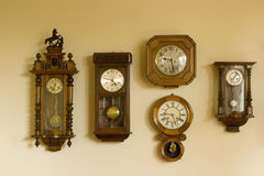 Clocks collection. Collection of antique wall clocks Stock Photos