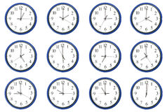 Clocks - Day and night hours Stock Image