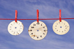Clocks dials on red string Royalty Free Stock Photography