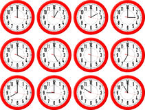 Clocks different times Stock Images