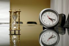 Clocks in the empty conference room royalty free stock photos