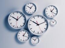 Clocks hanging at the wall Stock Photo