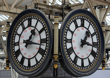 Clocks with 24 hours markings at Waterloo station. Two clock faces above the concourse at Waterloo station in London with both clocks showing markings for 24 Royalty Free Stock Photos