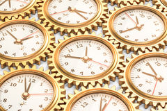 Clocks inside gears, time concept. 3D rendering Stock Photography
