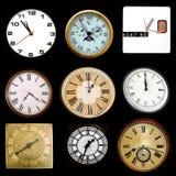 Clocks On Black Royalty Free Stock Photography