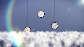 Clocks over clouds in the sky. Royalty Free Stock Images