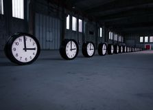 Clocks with red door in a factory royalty free stock photography