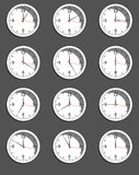 Clocks showing different time. Vector Royalty Free Stock Photo