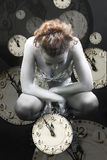 Clocks and silver girl Stock Images
