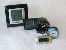 Clocks. Some table-clocks of different shape and size. Concept: Time Royalty Free Stock Images