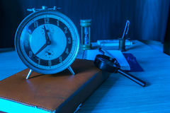 Clocks and stationery on table. Clocks and stationery on old wooden table royalty free stock photos