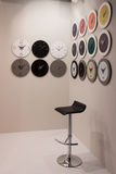 Clocks and stool at Macef home show in Milan Stock Image