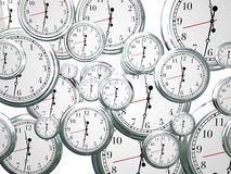 Clocks Time Passing Marching On Future Progress Moving Forward. Many clocks ticking and counting down the seconds, minutes and hours as time marches on and moves Stock Photography