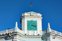 Clocks on the tower in Zhytomyr, Ukraine. Zhytomyr, Ukraine - December 12, 2011: Clocks on the tower of Zhytomyr City Council building on Mykhailivska street in Stock Photos