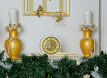 Clocks and vases in gold color Royalty Free Stock Images