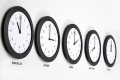 Clocks on wall, symbol for Greenwich Mean Time stock photo