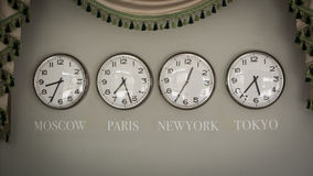 Clocks on a wall with time zone of different country Royalty Free Stock Image