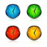 Clocks and watches - Set 1 - bright colours. Set of four colored clocks in blue, green, red and orange Royalty Free Stock Images
