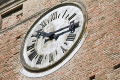 Clocktower. Closeup of the clocktower of Rossi Fortress of San Secondo Parmense. Emilia-Romagna. Italy Stock Image