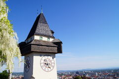 Clocktower in the light of the setting sun, background Graz Stock Photos