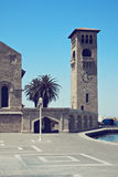 The clocktower at Mandraki harbour. Rodos, Greece. Toned photo stock photos