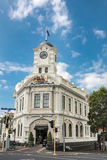 Clocktower mansion on Ponsonby Road, Auckland. Auckland, New Zealand - March 1, 2017: The cream white mansion with clock tower at intersection of Ponsonby Road stock photography
