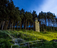 Clocktower in mountain Bulgaria. Night Stock Photo