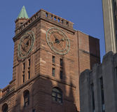 Clocktower in the Old City of Montreal, Canada. Clocktower of the Quebec Bank Building located in the Old City area of Montreal. The red sandstone used in the Royalty Free Stock Images