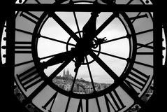 Clocktower in Paris. A clocktower in Paris looks out onto the quartier Montmartre with Sacre Coeur on top of a mountain Stock Images