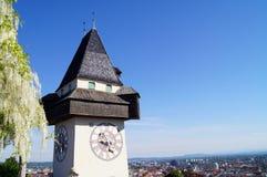 Clocktower teniendo en cuenta el sol poniente, fondo Graz Fotos de archivo