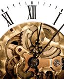 Clockwork. Clock dial, and clockwork. Gears and screws. Mechanical structure stock photo