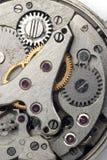 Clockwork. Old grungy wristwatch clockwork closeup stock photo