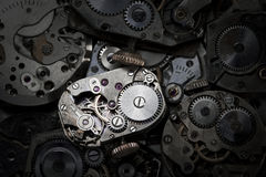 Clockwork. Close-up of antique clockwork. This is an extreme close-up of old clockwork so there is some dust visible royalty free stock photography