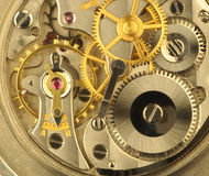 Clockwork. Close up of the precision technology of a fine Swiss clockwork royalty free stock images