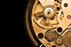 Clockwork. Macro isolated over the black background royalty free stock image
