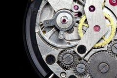 Clockwork. Macro isolated over the black background stock photos
