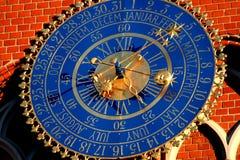 Clockwork. Antique astronomical clockwork on brick wall stock photo