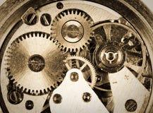 Clockwork. Old grungy wristwatch clockwork close-up royalty free stock photo