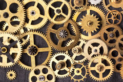 Clockwork cogs - Old brass clock parts Royalty Free Stock Images