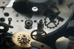 Clockwork. Fragmented with flying cogwheels Stock Photo