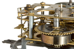 Clockwork gears. Macro of obsolete clockwork isolated on white background Royalty Free Stock Images