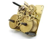 Clockwork gears. The image  of the cogs, wheels and gears of the inside of an old clock Stock Photos