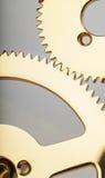 Clockwork gears. Macro view of two golden gears Stock Photos
