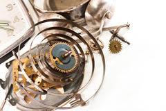 Clockwork. Gears, springs, nuts, mechanical alarm clock on a white background Stock Image